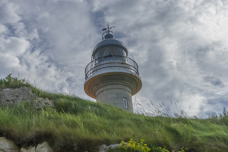 Navigation, coastal lighthouse on the Playa de los Locos in Cantabria, Spain Stock Photo