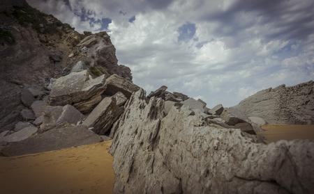 Coastline, Beach with rocks in summer. Playa de la Arnía in Santander, Spain Stock Photo