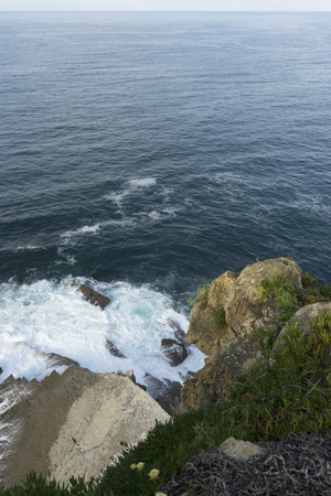 Scenic, Cliff, aerial view of rocks hit by the waves of the sea, Cantabria, Spain