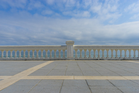 seafront promenade at Playa del Sardinero, view of the beach with a stone railing and the sea in the background, Santander, Spain