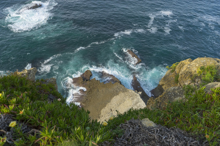 Cliff, aerial view of rocks hit by the waves of the sea, Cantabria, Spain