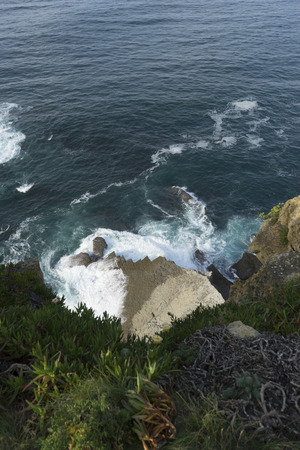 Rocky Cliff, aerial view of rocks hit by the waves of the sea, Cantabria, Spain