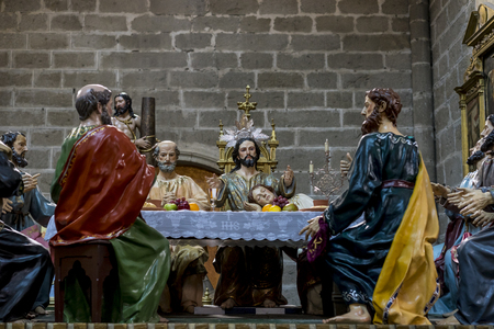 Avila, Spain - April 17, 2019. The Last Supper, religious images of the Holy Week footsteps inside the Cathedral of Ávila, Spain