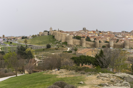 Tourism, View of the medieval wall of the city of Avila, in Spain. Spanish fortress
