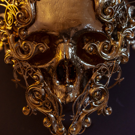 Skeleton, golden skull made with 3d printer and pieces by hand. Gothic piece of decoration for halloween or horror scenes Stock Photo
