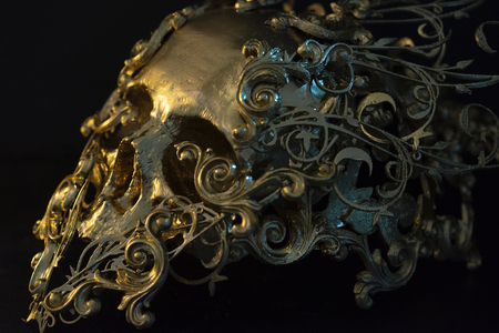 Gold, golden skull made with 3d printer and pieces by hand. Gothic piece of decoration for halloween or horror scenes Stock Photo