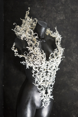 Manikin, Piece made with 3d printer, is composed of white flowers that form a corset, handmade, fantasy design Baroque style 写真素材