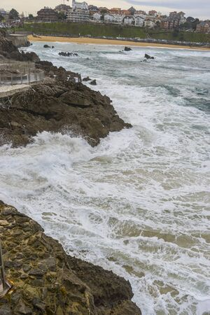 raging and furious sea breaking against the rocks, Cantabrian Sea in the North of Spain Stock Photo - 124882003