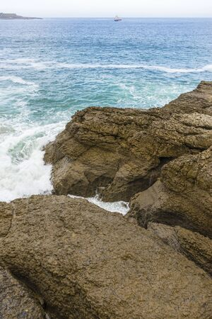 raging and furious sea breaking against the rocks, Cantabrian Sea in the North of Spain 스톡 콘텐츠