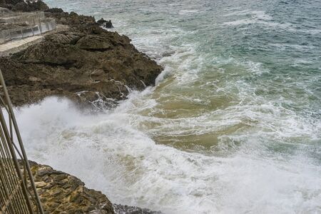 Danger, raging and furious sea breaking against the rocks, Cantabrian Sea in the North of Spain Stock Photo - 124984051