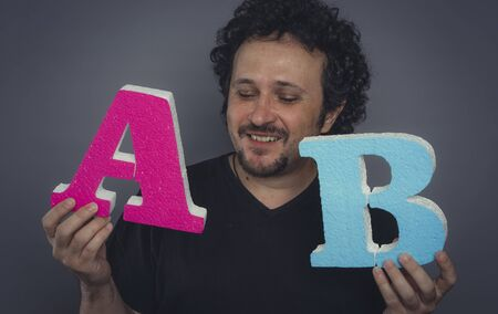 marketing specialist, A  B test error test in online advertising campaigns, test concept A and B. Man with large letters