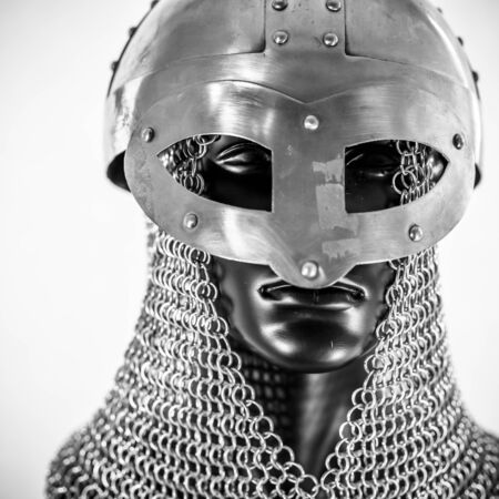 Metal, Viking helmet with chain mail in a black mannequin on white background. clothes for the viking war