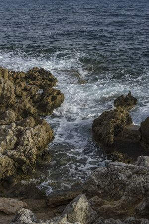 Travel summer, Mediterranean sea crashing against the rocks of the Spanish island of Mallorca, Ibiza, Spain.
