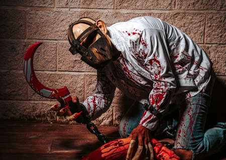 halloween costume, Man chained with blood and knife, Zombie man death the ghost horror drain hand blood skin is screaming darkness and nightmare background of scary fear on hell is monster devil  in halloween festival concept Standard-Bild