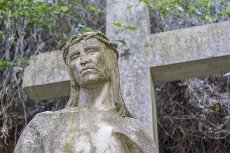 sculpture of jesus on the cross made in stone in the monastery of Montserrat in Barcelona, Spain