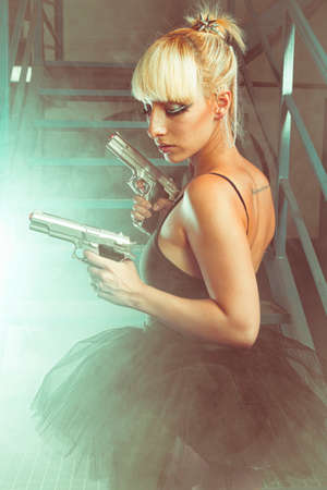 Cosplay, Blonde girl with pistols in an abandoned factory. cosplayer, action and dangerous woman