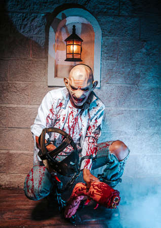 creepy, halloween costume, Man chained with blood and knife, Zombie man death the ghost horror drain hand blood skin is screaming darkness and nightmare background of scary fear on hell is monster devil  in halloween festival concept