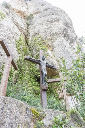 Catholic, sculpture of jesus on the cross made in stone in the monastery of Montserrat in Barcelona, Spain