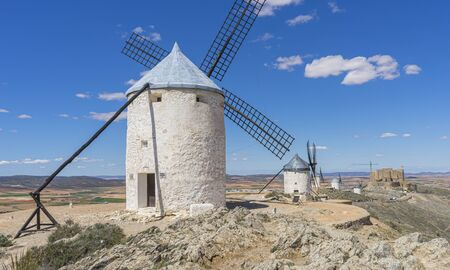 Energy, White wind mills for grinding wheat. Town of Consuegra in the province of Toledo, Spain Imagens