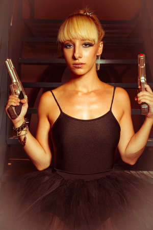 Cyberpunk, Blonde girl with pistols in an abandoned factory. cosplayer, action and dangerous woman