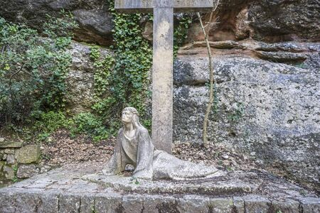 Calvary, sculpture of jesus on the cross made in stone in the monastery of Montserrat in Barcelona, Spain