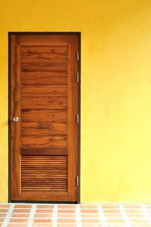 wooden door at yellow wall  photo