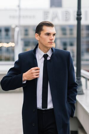 Man in a stylish suit. Businessman in an autumn city