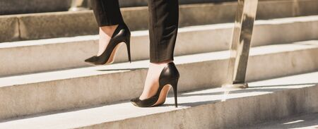 Closeup woman have pain in leg because wearing highheels. Concept about carrer and business Banque d'images