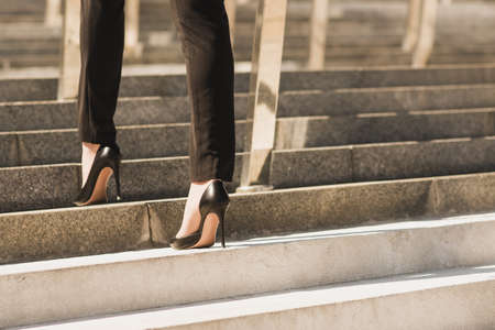 Closeup woman have pain in leg because wearing highheels. Concept about carrer and business