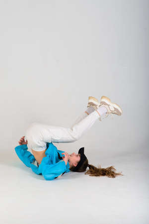 Teenage female dancing hip-hop in a studio, casual clothes