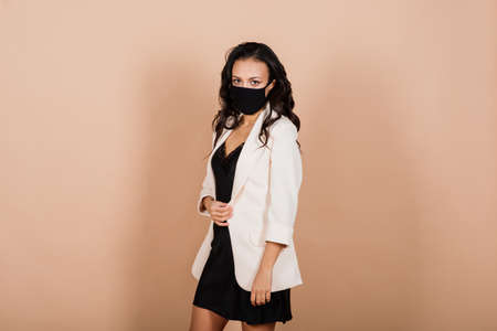 Portrait of an African American woman wearing protective mask during virus epidemic.