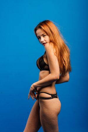 Portrait of female in khaki singlet and panties, underwear