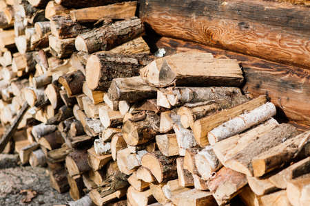 Woodpile of birch firewood, close up, background Texture
