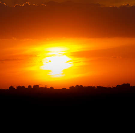 Silhouette of the city against the backdrop of the setting sun