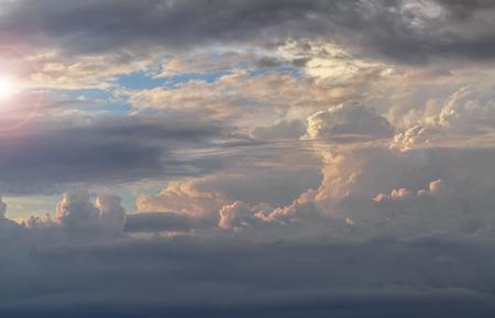 Beautiful cumulus clouds before sunset Stock Photo