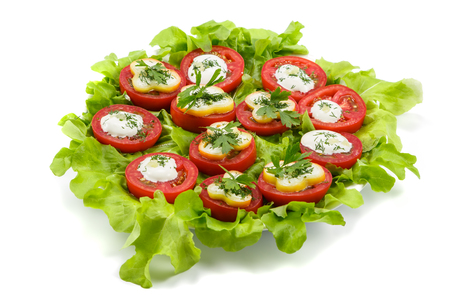 Tomatoes stuffed with cheese and sour cream Stock Photo