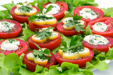 sour cream: Tomatoes stuffed with cheese and sour cream Stock Photo