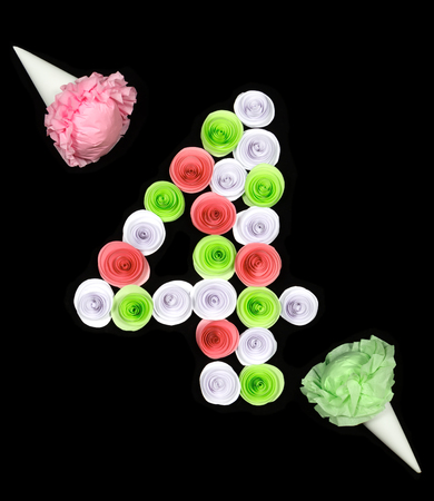 Decorative figure of four lined paper flowers