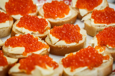 spawn: Many small sandwiches with red caviar