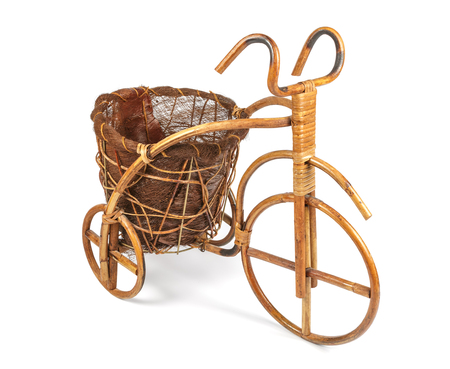vintage furniture: Flower stand in the form of a bicycle made from rattan. Right view Stock Photo
