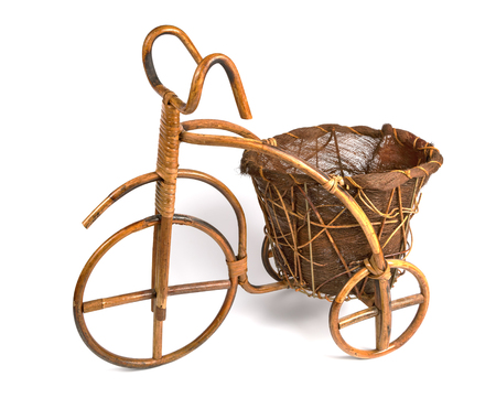vintage furniture: Flower stand in the form of a bicycle made from rattan. Left view Stock Photo