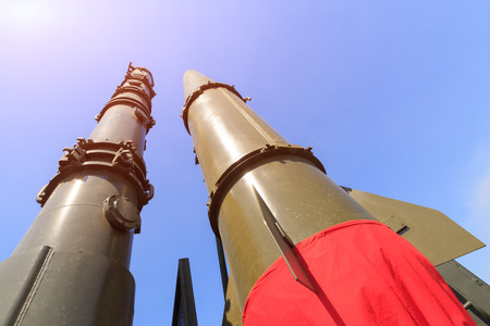 Rockets of missile complex Iskander are directed upwards on the blue sky background Фото со стока