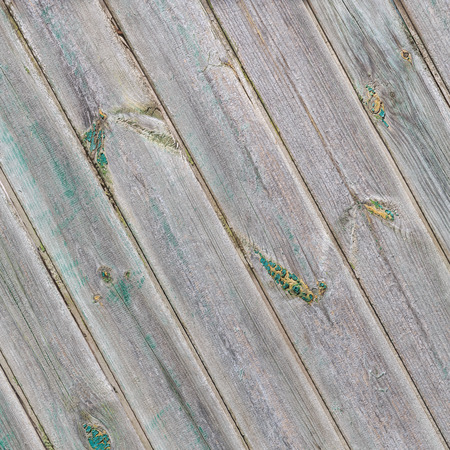 Vintage diagonal wooden boards with the remains of the green paint