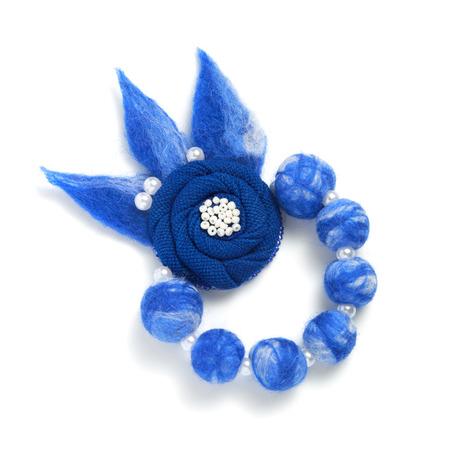 Handmade bracelet in the form of blue balls