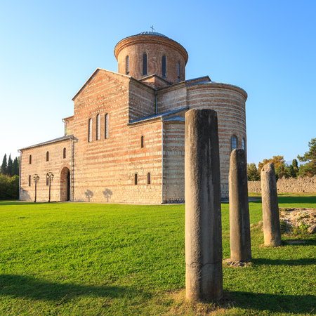 PITSUNDA, ABKHAZIA, SEPTEMBER 19, 2017: Ancient Patriarchal Cathedral in honor of the Apostle Andrew in Pitsunda in warm summer day Editorial