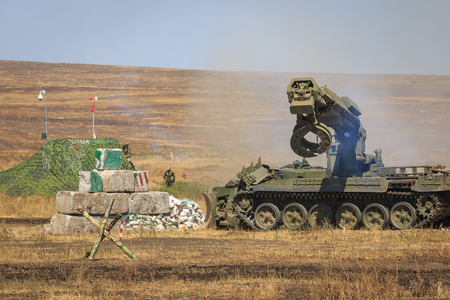 NOVOCHERKASSK, RUSSIA, 26 AUGUST 2017: The modern Russian armored combat engineer IMR-2 in the process of work at the military training ground at summer day