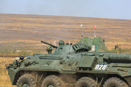 NOVOCHERKASSK, RUSSIA, 26 AUGUST 2017: Russian armored personnel carrier rides in the military firing range Editorial