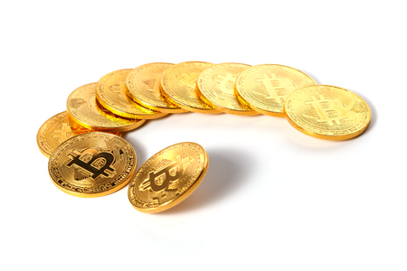 A few golden coins with the sign of a bitcoin lying in a semicircle on a white background