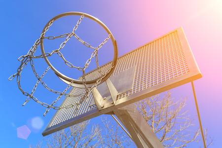 Modern anti-vandal metal basketball ring on a background of blue sky
