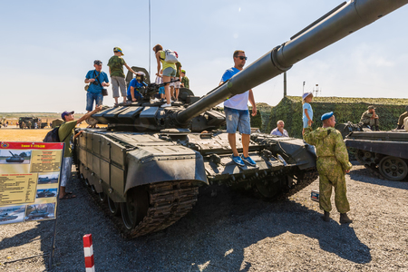 KADAMOVSKIY TRAINING GROUND, ROSTOV REGION, RUSSIA, 26 AUGUST 2017: International military technical forum ARMY-2017. Visitors of the exhibition inspect the main tank T-72B3M
